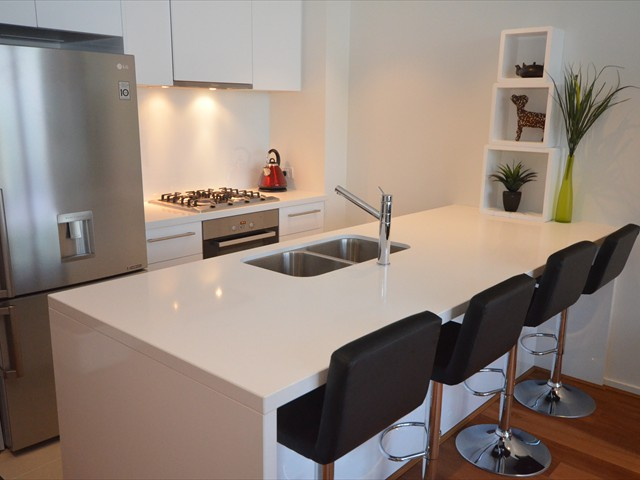 ABODE: Stainless Steel Kitchen, Stone bench top, Miele appliances