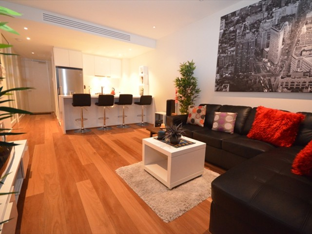 ABODE: Modern decor, light, quality furniture, wood flooring throughout