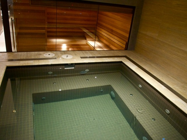 ABODE: 55th floor spa/jacuzzi with adjacent sauna with Melbourne city skyline views