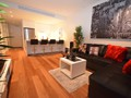 Modern decor, light, quality furniture, wood flooring throughout